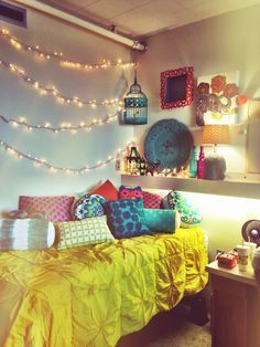Dorm Room. A strand of Christmas lights hung with command strips and some colorful accents can brighten up any room.
