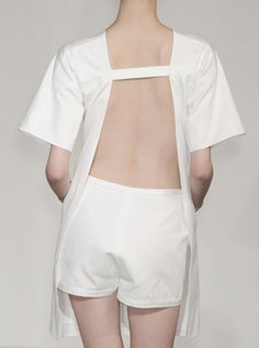 Contemporary Fashion - white shorts & minimal dress with open back detail
