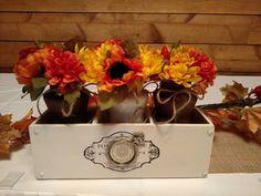 Fall flowers in spray painted jars.  I used tall taco sauce jars.