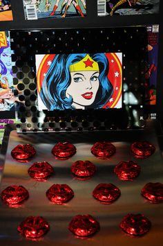 Red foil covered chocolate lips at Wonder Woman party