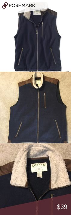 Orvis Sherpa Fleece Vest Men's L Orvis Sherpa Fleece Vest - Men's Large (42-44)- Navy - new condition - worn once   Sherpa Fleece Vest in 100% polyester fleece for increased warmth and durability.  The zippers have been improved for better performance with reduced weight.  Pockets are lined with tricot for added comfort. Trimmed with distressed faux leather Faux shearling lines the neck for optimum comfort and warmth, while a drawcord at the bottom hem helps shut out wind and cold.