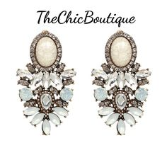 These big elegant earrings have cloudy white crystals. Fast and free shipping in the U.S. | Shop this product here: http://spreesy.com/TheChicBoutique/166 | Shop all of our products at http://spreesy.com/TheChicBoutique    | Pinterest selling powered by Spreesy.com