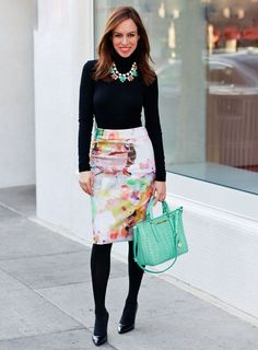 Shop this look on Lookastic:  http://lookastic.com/women/looks/turtleneck-necklace-pencil-skirt-satchel-bag-tights-pumps/6744  — Black Turtleneck  — Mint Necklace  — White Floral Pencil Skirt  — Mint Leather Satchel Bag  — Black Wool Tights  — Black Leather Pumps