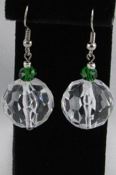 Round acrylic faceted clear focal beads, emerald green rondelle beads, and small silver tone spacer beads