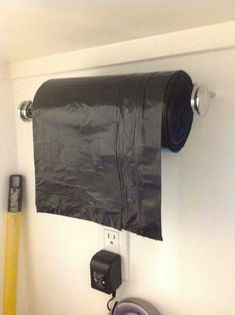 .Use a strong paper towel type rod to store your garage garbage bags.   No more big box taking up valuable shelf space.