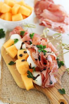 Melon, Proscuitto, and Mozzarella Skewers   This holiday appetizer looks so fancy but is so simple to make!