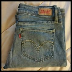 Levis Bootcut 524 Light wash Jeans Levis bootcut jeans in a light wash with a slight distress design. In like new condition size 7 or 28w x 32L. Sit near hips. Levi's Jeans Boot Cut