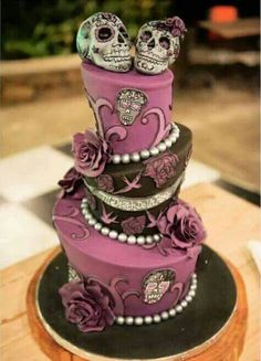 Simple and elegant halloween wedding cakes ideas in purple Skull Wedding Cakes, Gothic Wedding Cake, Sugar Skull Wedding, Gothic Cake, Purple Wedding Cakes, Wedding Cakes With Flowers, Elegant Wedding Cakes, Flower Cakes, Elegant Cakes