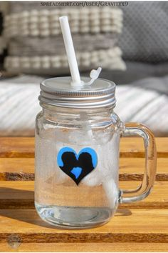 * Silhouette Couple Mason Jar Mug / 12 oz Drinking Glass by #Gravityx9 at Spreadshirt * Incl. Screw cap and reusable white drinking straw. * A fun gift for friend, wedding couple, gift for coworker or family. * This design is available on coffee mugs, scarves, home decor and more. * Silhouette of loving couple on a blue heart * Drinking Glass * Mason Jar Drink Ware * #drinkingglass #masonjar #masonjarmug #mug #ValentinesDay #love #Couple #marriage 0920