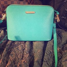 Michael Kors Crossbody ❤️ Perfect for summer , turquoise/ seafoam green  ❤️inspired❤️ cross body . Brand new , never used . Fun and bright for the warmer weather . Structured and great quality rep. Michael Kors Bags Crossbody Bags
