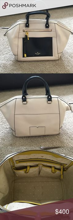 Kate spade Madison collection handbag Large Handbag. It has a zipper pocket in front, zipper pocket inside and 4 pockets to carry a cell phone and other goodies. It was my workbag so it has some scratches on the front side (picture listed) and a couple stains inside bottom part (picture listed). It's a beautiful bag, purchased in New York at their Madison location. kate spade Bags Satchels