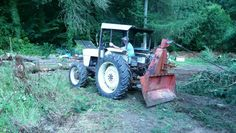 My 990 4wd winching a Scots pine.