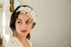 This intricately hand-beaded dimensional head piece was inspired by nature and the decorative era of Art Nouveau.