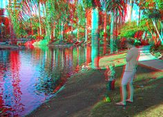 Child with adult stand in by a tropical water area.  Anaglyph 3D Paradise | Recent Photos The Commons Getty Collection Galleries World Map App ...