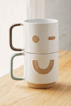 Stacking mugs happy face