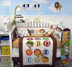 ABC 123 Jungle Animals crib bedding set featuring a giraffe, lion, monkey, and elephant.  Super Cute!