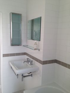 Catalano Canova Royale sink; grey crackle glazed tiles from Fired Earth, white elongated metro tiles from Topps Tiles, 1930s bevelled edge mirror