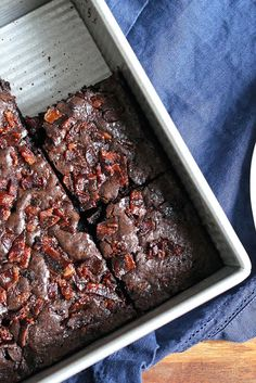 "Truly Decadent Bacon Brownies Recipe - Moist, dark fudge brownies with the smoky allure of crunchy bacon bits — what a tempting combination! Bacon, baked with brown sugar to ""candy"" it, is sprinkled atop the brownie batter just before baking. The result? Salt, sweet, and smoke in each delicious bite. Our thanks to the folks at @applegatefarms for suggesting this recipe; we made these brownies with their Natural Sunday Bacon."