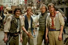 Fra Free (Courfeyrac), Alsitair Brammer (Prouvaire), Hugh Jackamn (Jean Valjean) and Killian Donnelly (Combeferre) on the set of Les Miserables