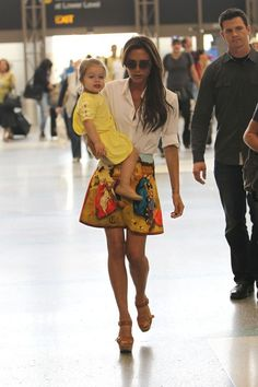 Victoria Beckham in a Carven skirt. (How cute is Harper?!)