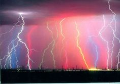 While the vivid white light we associate with lightning is an example of incandescence, with a temperature in the order of 30,000 K, its colors also stem from gas excitations - light emitted through the excitation of gas molecules in the atmosphere.