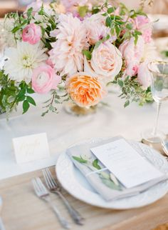 Dahlias and ranunculus: http://www.stylemepretty.com/2014/10/14/soft-romantic-summer-winery-wedding/ | Photography: KT Merry - http://www.ktmerry.com/