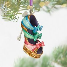 Disney Good Fairies Shoe Ornament - Sleeping Beauty | Disney StoreGood Fairies Shoe Ornament - Sleeping Beauty - The three good fairies from <i>Sleeping Beauty</i> are magically transformed into a decorative shoe in this beautifully detailed ornament. The colorful straps are inspired by Flora, Fauna, and Merryweather, while the heel is a magic wand.