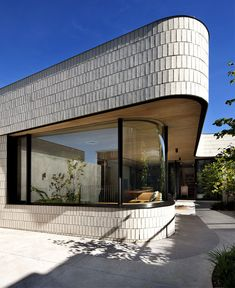 Brick House with Smooth Curves extension main house