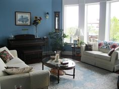 Paint colors that match this Apartment Therapy photo: SW 6174 Andiron, SW 6258 Tricorn Black, SW 6202 Cast Iron, SW 0048 Bunglehouse Blue, SW 2832 Colonial Revival Gray