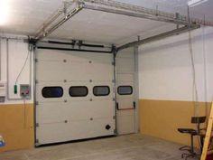 Instalación puerta seccional de garaje valenciacerrajeros.es