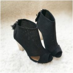 """⭐️DISCOUNT SHIP!⭐️NIB Black Cut-Out Ankle Booties NIB Black Cut-Out Ankle Booties. These versatile booties feature a perforated vegan suede with side cut-outs, peep toe, and a chunky stacked heel. Tassel pull on a gold back-zip closure at the heel. Lightly padded insole, approx 4"""" heel. FITS TRUE TO SIZE. Available in 5.5, 6, 6.5, 7, 7.5, 8, 9, 10. No Trades and No PaypalPrice is firm unless bundled, also available in taupe color, see my closet for taupe listing. Sold out of 8.5 Shoes Ankle…"""