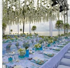 Love the dangling floral arrangements from the top of the tent