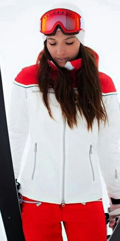 Jacynta in a white with flame red (same on her ski pants) on her shoulders of her ski jacket.