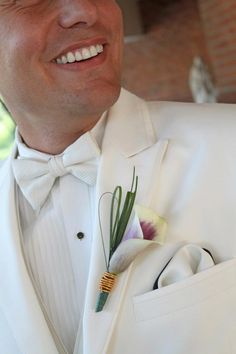 Never mind those pearly whites, check out that beautiful boutonniere!  That Picasso Cala Lily matched my (the bride's) bouquet perfectly!  The wedding colors were eggplant, metallic gold, and chartreuse, so the gold wire wrapped the flower and incorporated one of our colors.