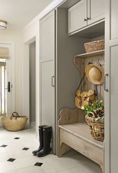 the cabinetry in this mudroom is painted  in a color that's Warmer than gray but cooler than taupe. this neutral, earthy shade is popping up everywhere