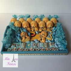 Safari themed trays for baby shower with wrapped chocolates and cute trinket boxes.