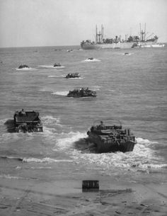 """Caption from LIFE. """"Amphibious trucks ferry supplies from cargo ship to Anzio beach. A few minutes before, a number of them had been sunk in attack by German fighter-bombers."""" Read more: Anzio: Rare and Classic World War II Photos From Italy 