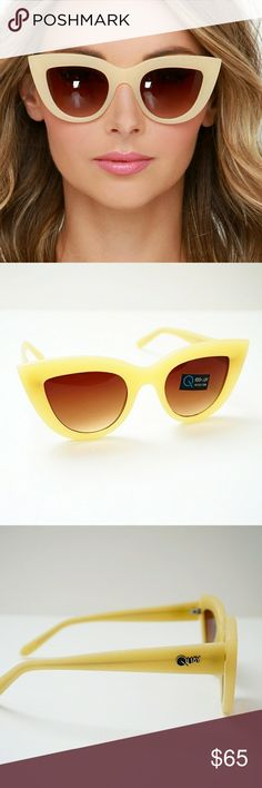 Quay Australia Kittie Sunglasses CONDITION: Pre-owned, but in good condition. Minimal signs of wear.   MATERIAL: Plastic frame, polycarbonate lens and stainless steel hinges  MEASUREMENTS: Width: 5.7 in.  Height: 1.9 in.  Nose Gap: 0.31 in. Quay Australia Accessories Sunglasses