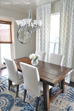 Bright and Beautiful Breakfast Room with Our Benchwright Table Love the contrast of the dark table against the white chairs and blue and white rug.Love the contrast of the dark table against the white chairs and blue and white rug. Kitchen Table Chairs, Dinning Room Tables, Table And Chairs, Dining Rooms, Wood Table, Dining Chairs, Dinning Room Curtains, Rectangle Dining Table, Small Dining
