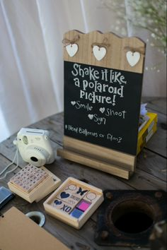 Shake it like a Polaroid picture! Fujifilm Instax mini camera + stamps = hilarious guest book