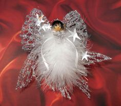 Buy Phoebie - Silver Christmas Angel, Handmade, Xmas Angel, Feather Angel, Ornament, Christmas Tree Ornament, Holiday Ornament, Victorian Angel by angelsofheaven. Explore more products on http://angelsofheaven.etsy.com