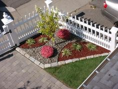 Mixing landscaping stones and mulch. More