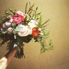 Garden rose and peony bridal bouquet by Mya Frey.