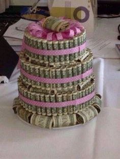 The best gift cake, ever! Maybe place it under a dome/domed cake stand if you wanted to display it for/at the party. #Money #MoneyCake