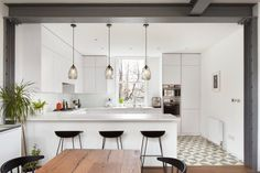 Patterned tiling, oak floorboards and a sliding translucent screen all feature inside this refurbished home in a century London mansion block White Apartment, Apartment Kitchen, Kitchen Interior, Kitchen Decor, Kitchen Ideas, Küchen Design, House Design, Design Studio, London Mansion