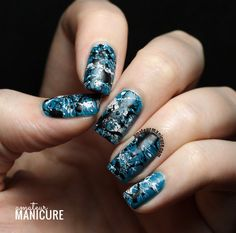 Black and White and Blue All Over Splatter Nail Art via @amateurmanicure