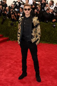 Pin for Later: Relive All the Glamour From Last Year's Met Gala Red Carpet Justin Bieber Even Justin dressed for the theme in a gold-embroidered jacket.