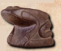 """""""Frog Effigy Pipe"""", Cahokia style, Missouri flint clay, Mississippian culture, found in the Craig Mound at the Sprio Site in Oklahoma. The style of this pipe indicates that it may have been made in the Cahokia Mounds area. The frog is sitting on a platform which is a common feature on other Cahokia style pipes."""