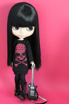 Blythe doll...I would love to have a whole collection of them, but as much as they cost, I'll be lucky if I ever get just one!