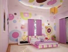 Pink Themed DIY Kids Room Design with Modern Line Pattern Bed Frame that have Doll Toys on the Mattress and Beautiful Rounded Pattern Wall Paint Decorating also Flat Style White Bedside Table that have Unique Table Lamp